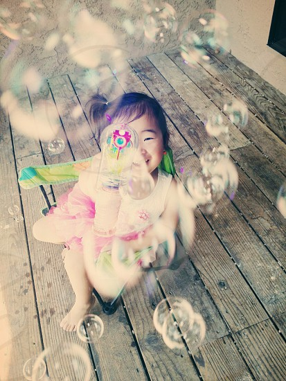 Playing with bubbles photo