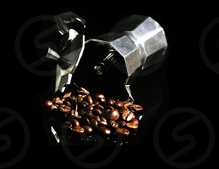 coffee beans and mocha machine on black background photo