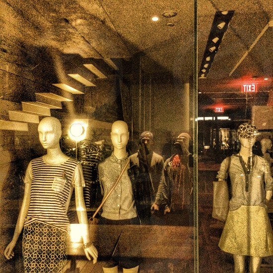 thre mannequins with clothes photo