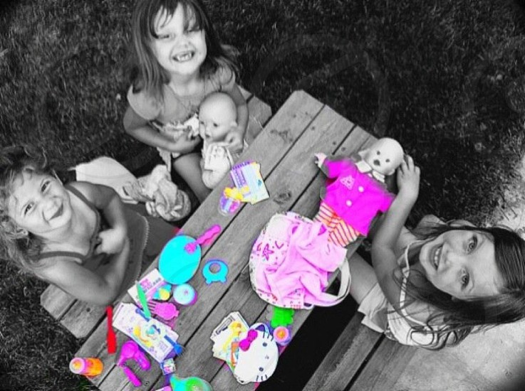 Girls dolls tea party picnic table smiles photo