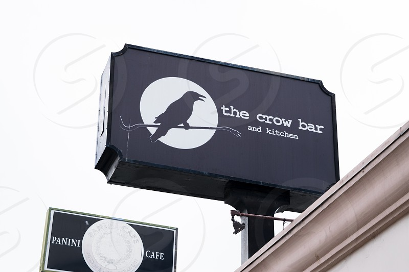 the crow bar and kitchen signage photo