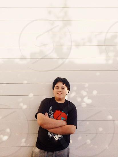 boy's black printed shirt photo