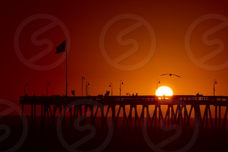 Sunset over pier photo