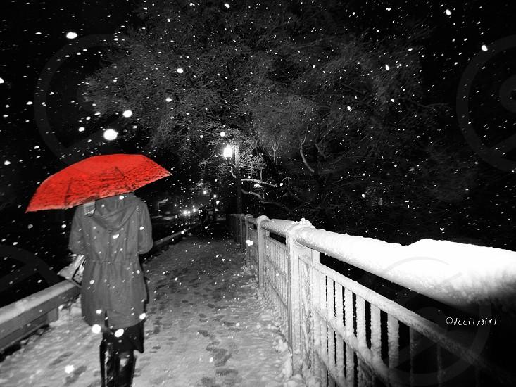 person in red umbrella in the snow  photo