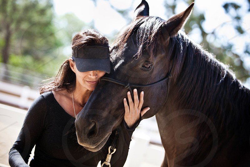 A woman and her horse. photo
