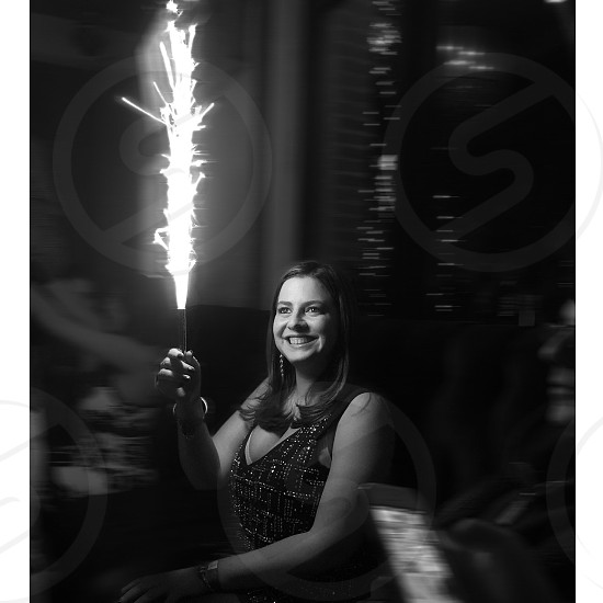 woman holding fire cracker photo