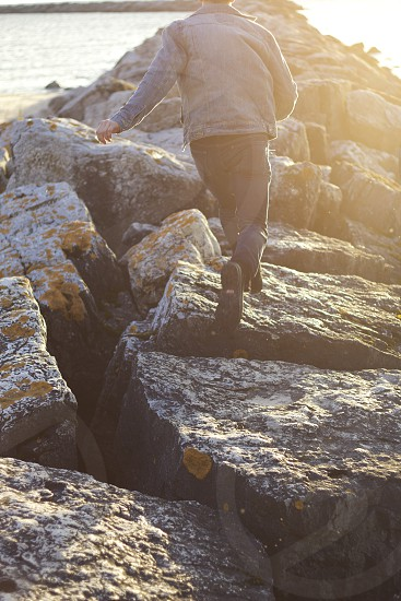 man on rock formation photo