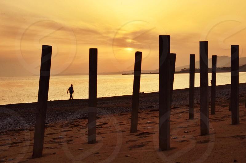 man walking on beach photo