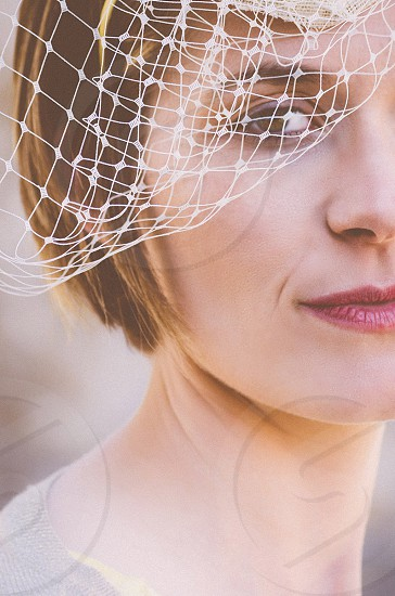 human face wearing short net vale photo