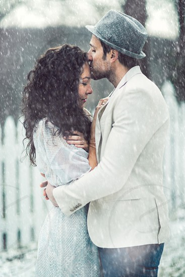 Snowy engagement in the hudson river valley New York. photo