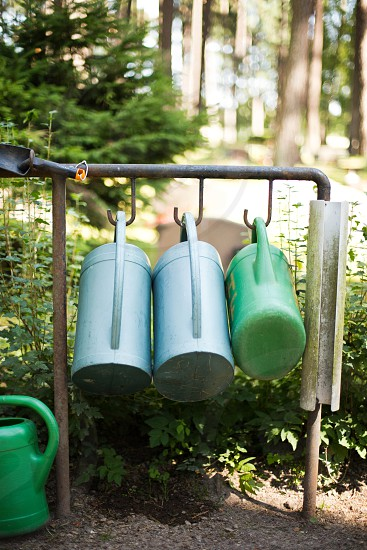 watering cans garden gardening garden tools garden supplies forest yard work grounds keeping grounds cemetery photo