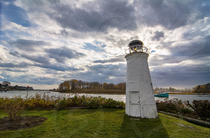 Kennebunkport Maine water bay lighthouse clouds blue sky photo