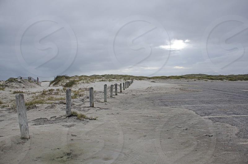 beach wave ocean sea Texas gulf coast grey sand desolate empty photo