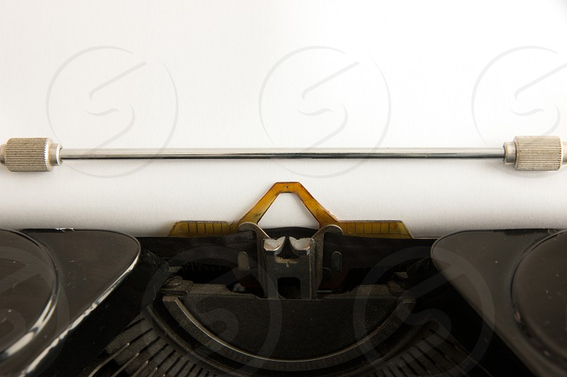 Typewriter with an empty sheet of paper. photo