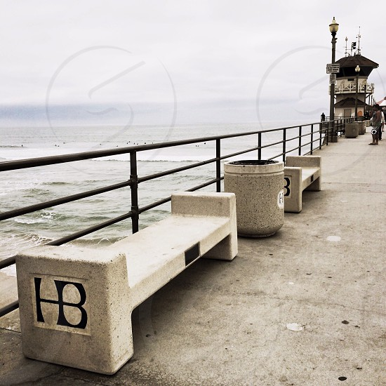 grey bench by the sea walk photo