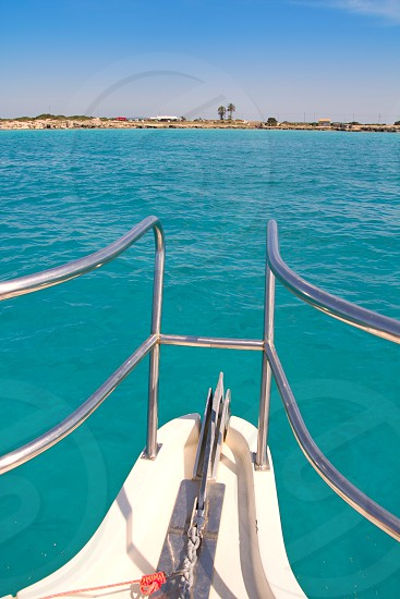 boat bow in Illetes Formentera Ibiza island with turquoise Mediterranean photo