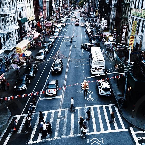 people crossing in the pedestrian lane in a busy street photo