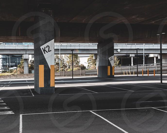 Car park empty space concrete jungle Melbourne concrete pillar south bank spring day light shade freeway overpass empty photo