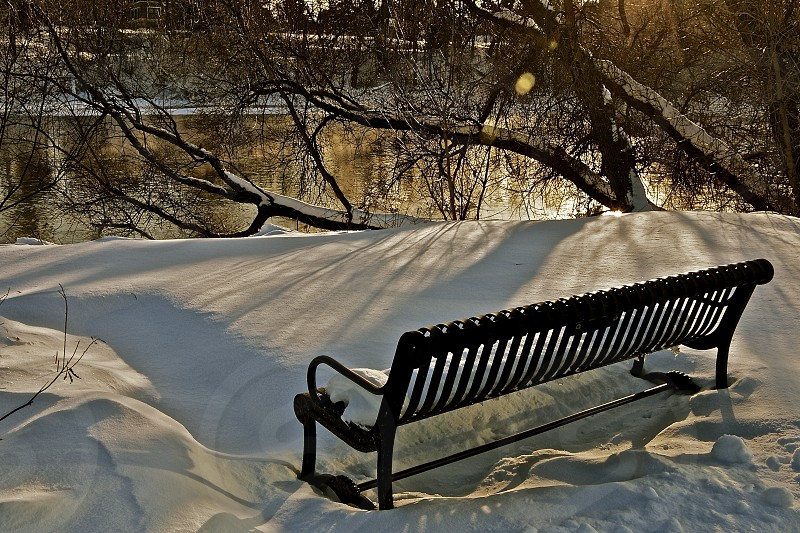 park bench beside winter mississippi headwaters photo