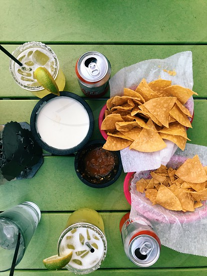 sweet summertime – tacos chips and salsa and margaritas outside. photo