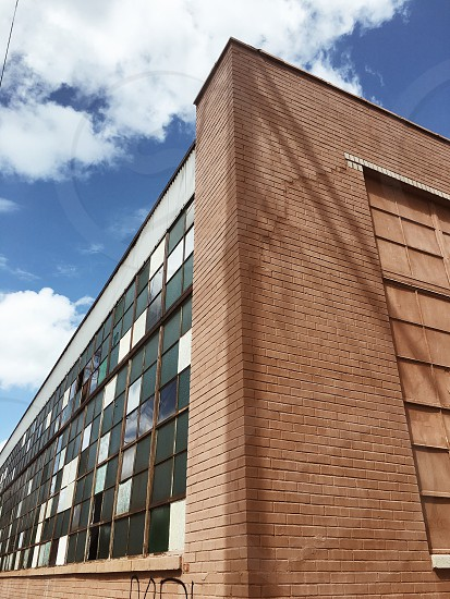 brown brick building under clear blue sky photo