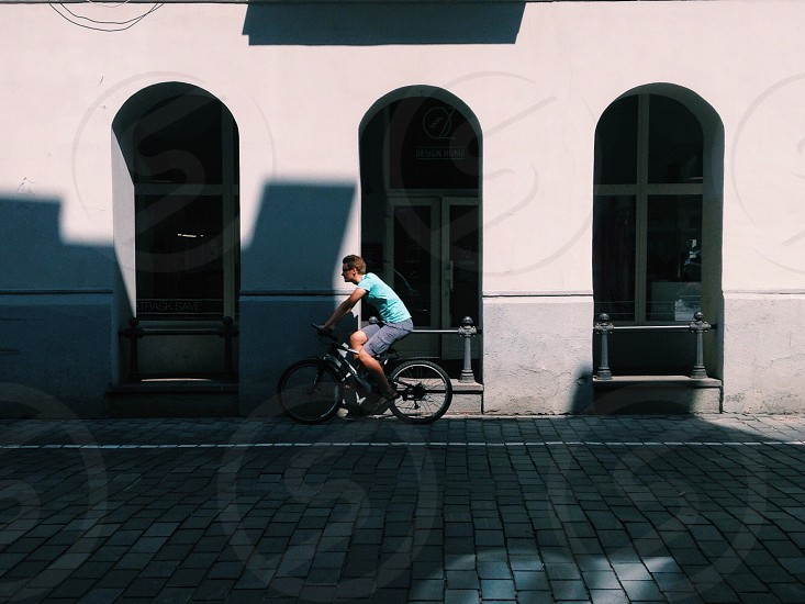 Man on a bicycle. Shadow play photo