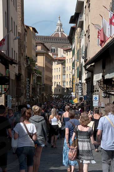 Busy street in Florence with the top of the duomo visible photo