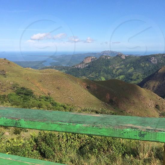 Mountains; greenery; panorama; green; fence; ocean; clouds; Panama photo