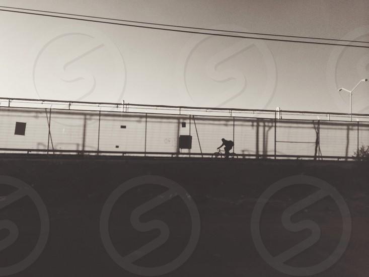 man riding bicycle silhouette  photo