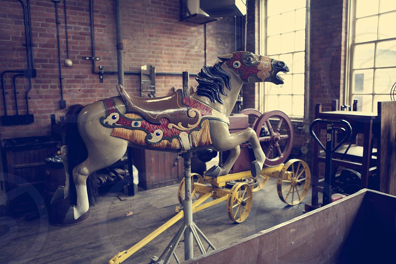 brown and white horse ride toy photo