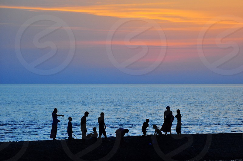 people at the beach photo