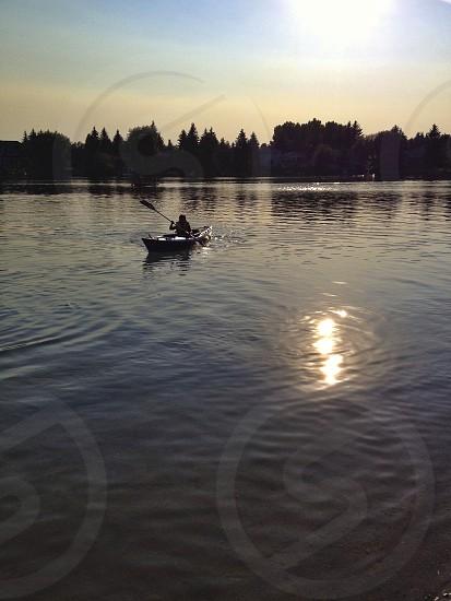 boy kayaking on a lake photo