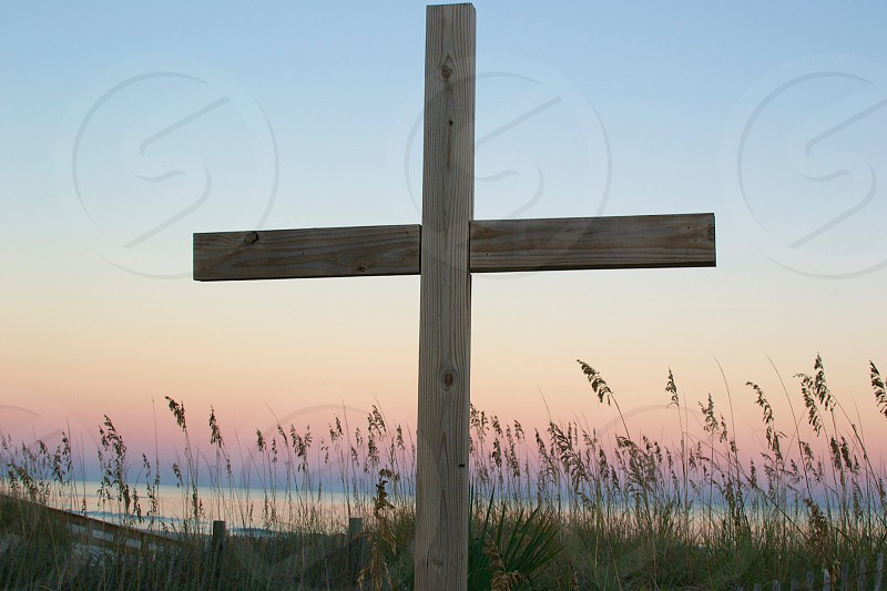 wooden cross in plains area photo
