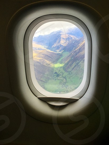 New Zealand Queenstown mountain valley green clouds flying plane air aeroplane flight window view height look looking photo