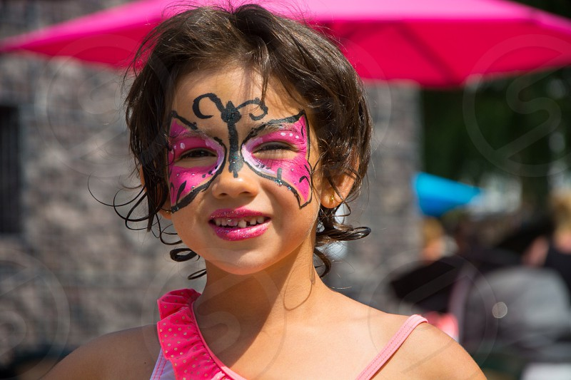 Pink little painted girl photo