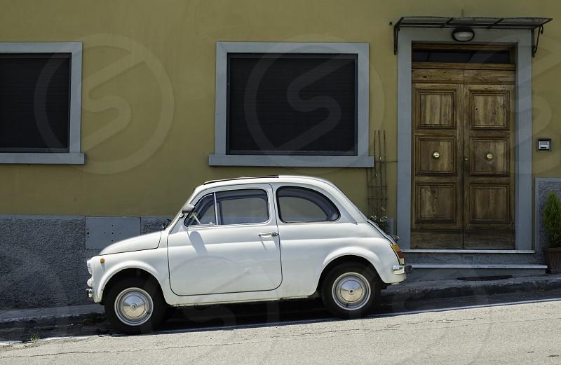 White small vintage Fiat Abarth. Sin light photo