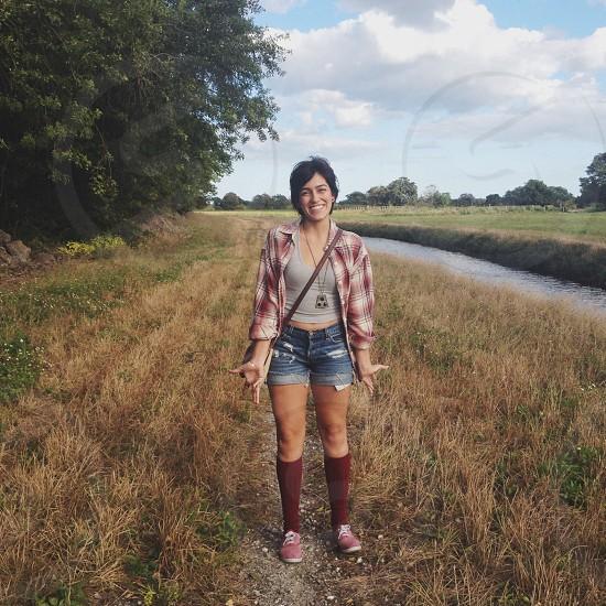 woman standing wearing denim daisydukes photo