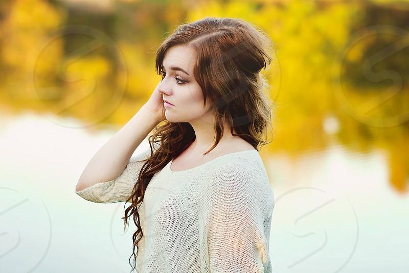 girl's cream knit sweater photo