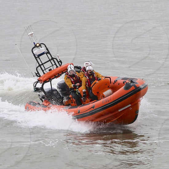 Lifeboat in action on the River Mersey Liverpool England. photo