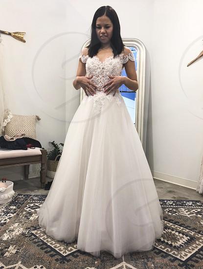 Trying on wedding dresses  photo