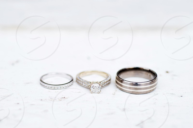 wedding and engagement rings in a row photo