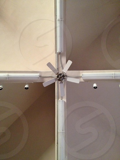 room with white 5 bladed ceiling fan and spot lights photo