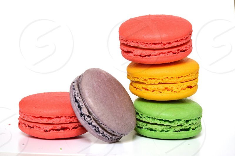 red yellow green and black macaroons photo