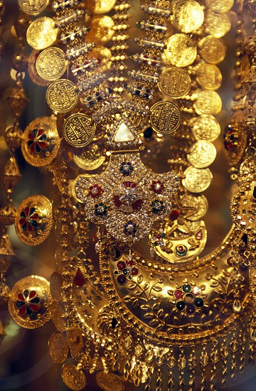 a Gold shop the souq or Market in the old town in the city of Dubai in the Arab Emirates in the Gulf of Arabia. photo