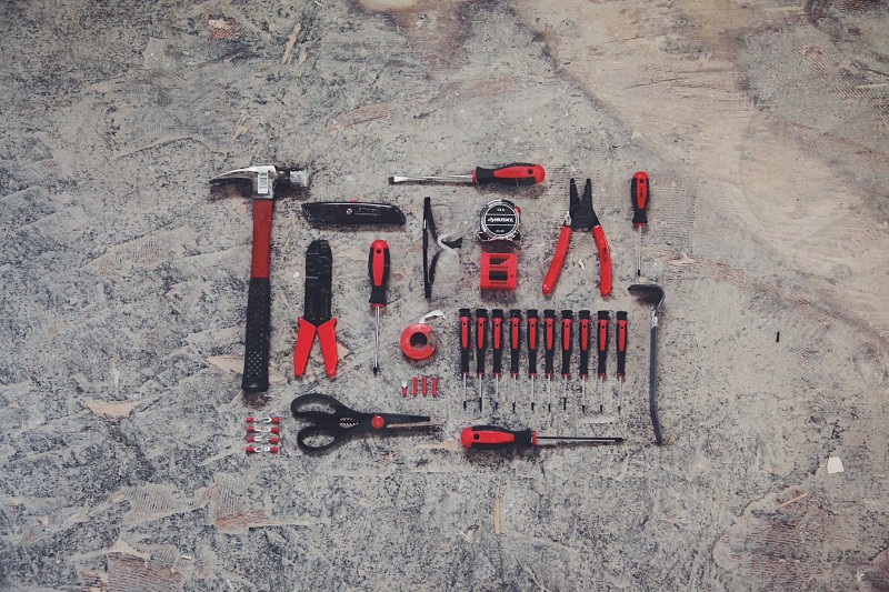 red and black construction tools photo