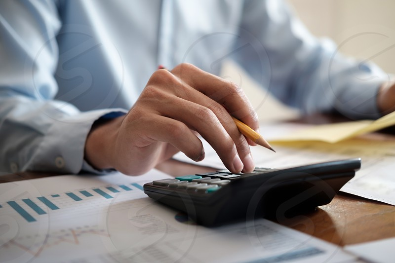 Finances Saving Economy and Investment concept. Accountant or banker use calculator.  photo