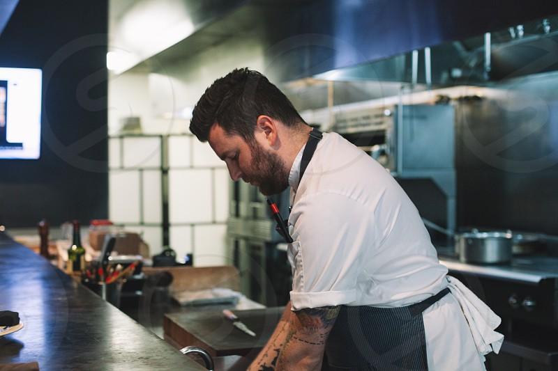 chef preparing food in kitchen photo