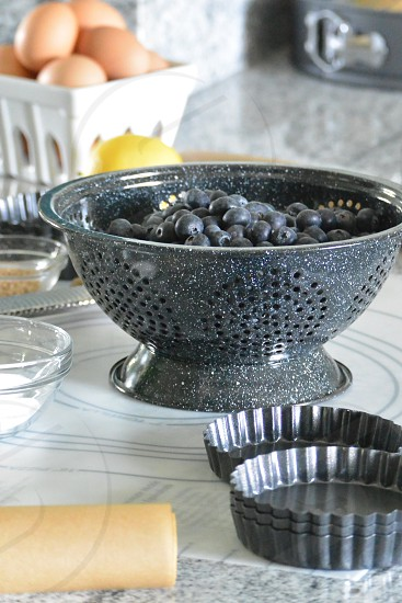 closeup photography of stainless steel cupcake molder near black beans on grey glittered footed bowl during daytime photo