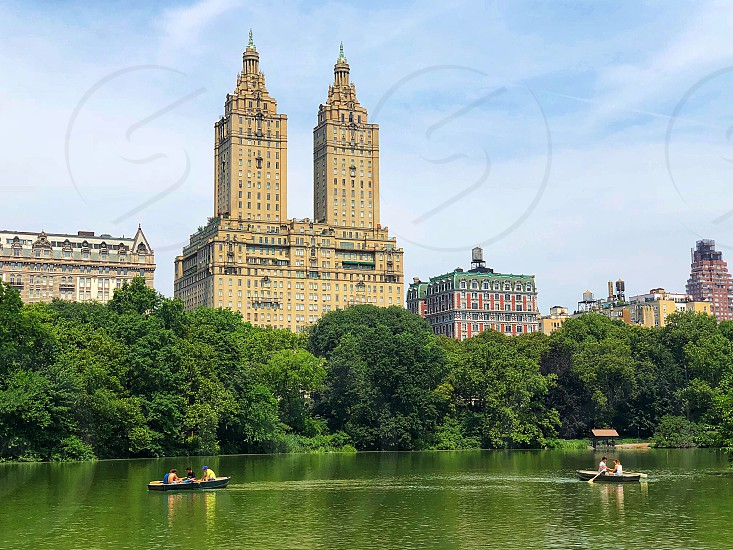 Central Park summertime boating boats lake historic buildings trees scenic background tranquility beauty in nature beautiful  photo