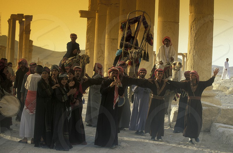 people near the town of Palmyra in Syria in the middle east photo